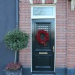 Christmas wreath on a door — Stock Photo
