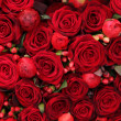 Foto Stock: Ranunculus, berries and roses in group