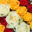 Yellow, white and red roses in a wedding arrangement — Stock Photo #26072331