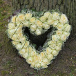 Stock Photo: Heart shaped sympathy flowers