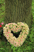 Heart shaped sympathy flowers — Stock Photo