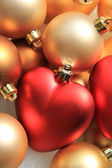 Lovely Christmas: red on gold ornaments — Stock Photo