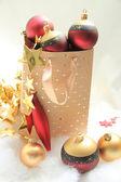 Giftbag with christmas ornaments — Stock Photo