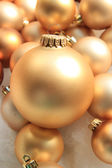 Golden Christmas ornaments — ストック写真