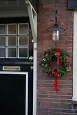 Frontdoor with christmas decorations — Stock Photo