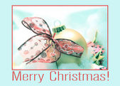 Ornament and bow Christmas card — Stock Photo