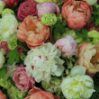 Peonies in a wedding arrangement — Stock Photo #27122913