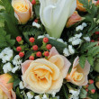 Stock Photo: Roses and lillies in a bridal arrangement