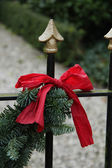 Red bow on a garland — Stock Photo