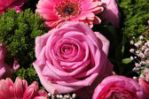 Pink rose in a bridal arrangement — Stock Photo