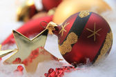 Christmas ornament and golden star — Stock Photo