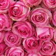 Big pink roses in a wedding centerpiece — Stock Photo