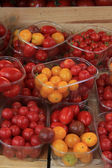 Small tomatoes at a market — Stock Photo