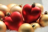 Red heart shaped christmas ornaments — Stock Photo