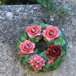 Ceramic flowers funeral wreath — Stock Photo