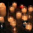Stock Photo: Votive candles in church