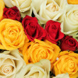 Yellow, white and red roses in a wedding arrangement — Stock Photo #31306065