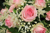 Pink roses and stephanotis in bridal bouquet — Stock Photo