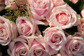 Pink roses in a wedding centerpiece — Stock Photo