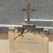 Tombstone with cross ornament at a French cemetery — Stock Photo #31435997