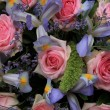 Blue irises and pink roses in bridal arrangement — 图库照片