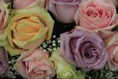 Pastel roses in bridal arrangement — Stock Photo