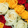 Yellow, white and red roses in a wedding arrangement — Stock Photo #32839637