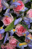 Blue irises and pink roses in bridal arrangement — Stock Photo