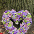 Heart shaped sympathy flowers — Stock Photo #34320023