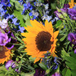 Sunflowers and purple eustoma — Stock Photo
