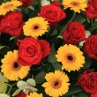 Yellow and red flowers in a bridal arrangement — Stock Photo