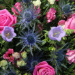 Floral arrangement in blue, purple and pink — Stock Photo