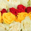 Yellow, white and red roses in a wedding arrangement — Stock Photo #37767217