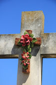 Crucifix with ceramic flowers — Stock Photo