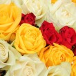Yellow, white and red roses in a wedding arrangement — Stock Photo #44417359