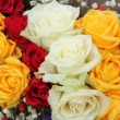 Yellow, white and red roses in a wedding arrangement — Stock Photo #45370177