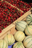 Melons and cherries — Stock Photo