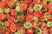Orange and yellow roses in a bridal bouquet — Stok fotoğraf