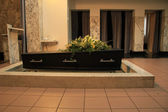 Funeral flowers on a casket — Stock Photo