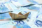 Sailing on money — Stock Photo