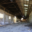 Deserted empty warehouse — Stock Photo