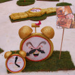 Fallas - the clock colorful funny figures — Stock Photo