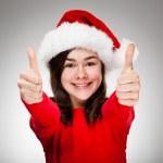 Girl showing OK sign wearing Santa Claus hat — Stock Photo #13753263