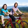 Girls riding bikes — Stock Photo #13753155