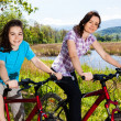 Girls riding bikes — Stock Photo #13753166