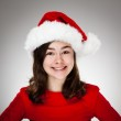 Portrait of beautiful girl wearing Santa Claus hat — Stock Photo #13753258