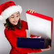 Portrait of beautiful girl holding present box — Stock Photo