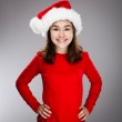 Portrait of beautiful girl wearing Santa Claus hat — Stock Photo #13753297