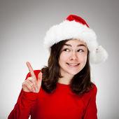Portrait of beautiful girl wearing Santa Claus hat — Stock Photo