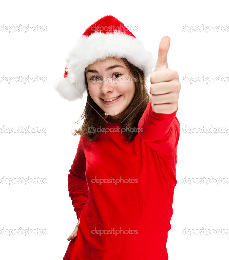 Portrait of beautiful girl wearing Santa Claus hat  Stock Photo #13753302